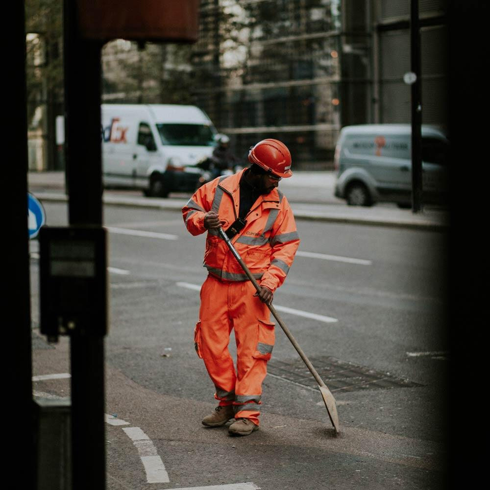 A construction worker wearing traffic safety equipment